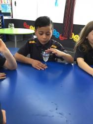 Room 4 Making sounds on the crystal glass2. Te Ramaroa concentrating on creating sound. 2
