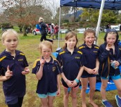 3 Year 4 girls with a 1st and 2nd placing awesome effort over all by everyone